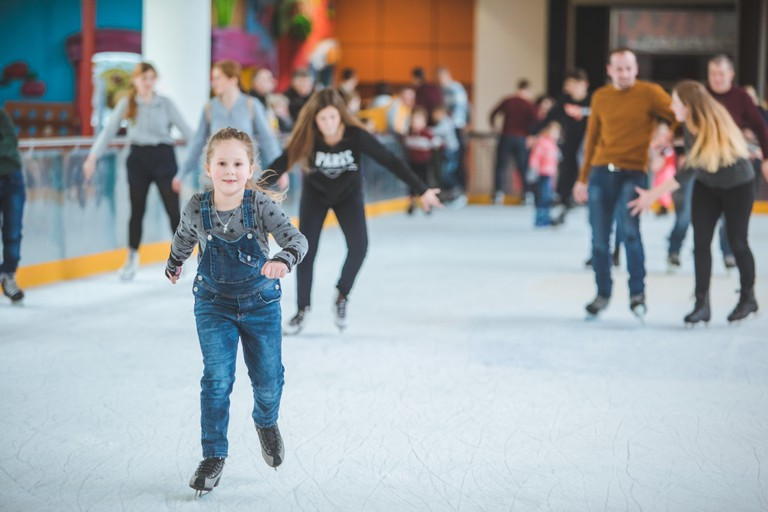 LVIV, UKRAINE - February 3, 2019: people skating on ski rink in city mall