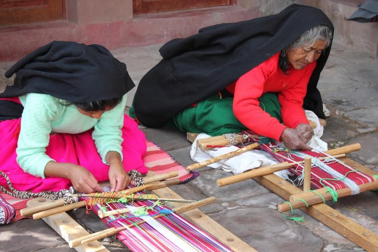 Women Weaving Calendar Waistbands on Taquile Island, Lake Titicaca, Peru