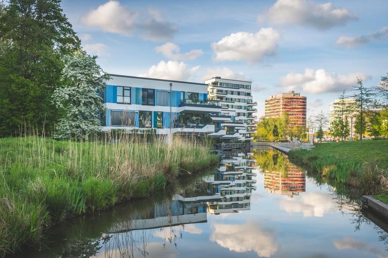 Lake amidst plants against sky in Inselpark, Hamburg, Germany