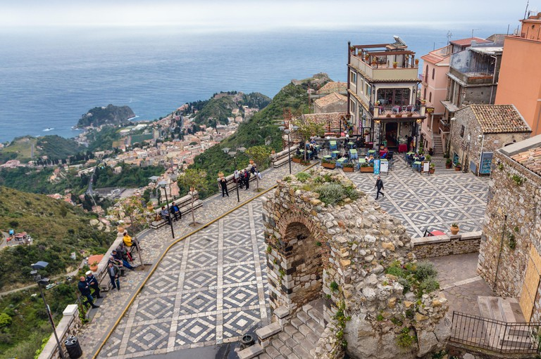 Piazza Saint Antonio, main square of Castelmola town in the Province of Messina in the Italian region Sicily - Taormina city on background