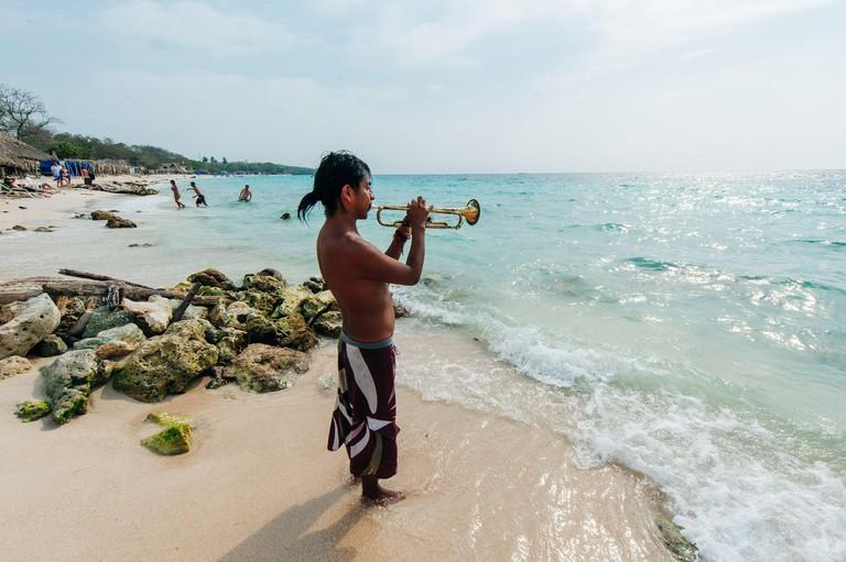 Colombia, cartagena - june 2019 View on paradies beach of Playa Blanca WITH saxophonist on Island Baru by Cartagena