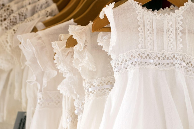 White cotton and lace dresses for sale in a traditional shop in the ancient town of Eivissa (Ibiza OldTown)
