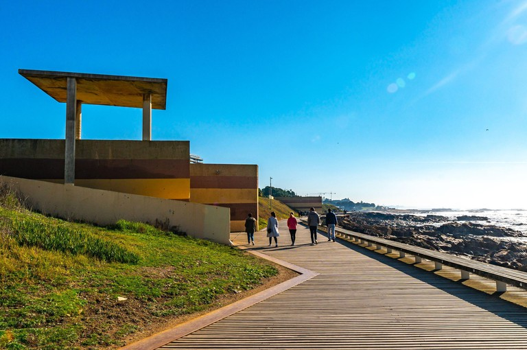 Porto Homem do Leme Beach Picturesque View with Walking People on a Sunny Blue Sky Day