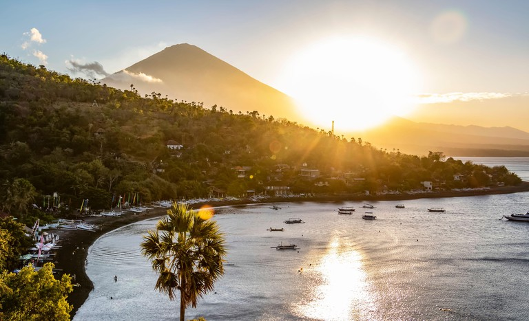 Amed Beach with Mount Agung in the background at sunset; Bali, Indonesia