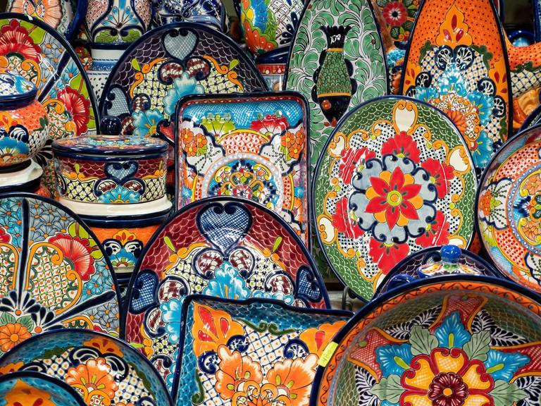Colourful pottery on sale at street market and souvenir shop in San Miguel de Allende, Guanajuato, Mexico.