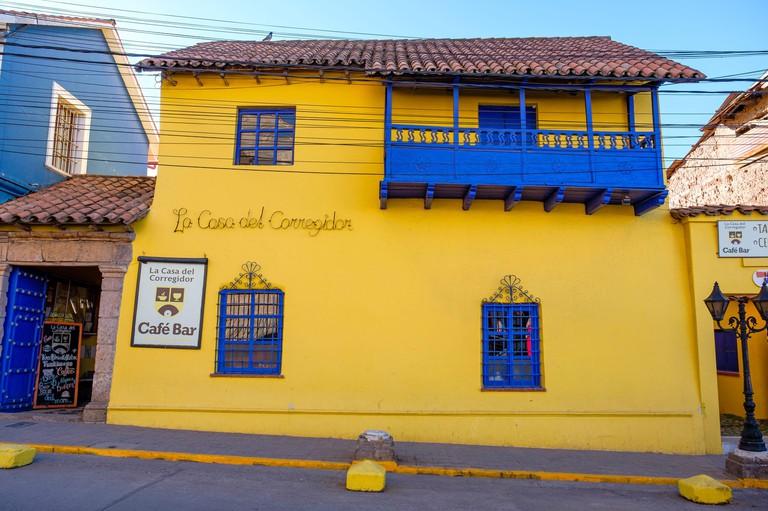 Restaurant, colourful yellow facade of Cafe Bar La Casa del Corregidor, Puno, Peru