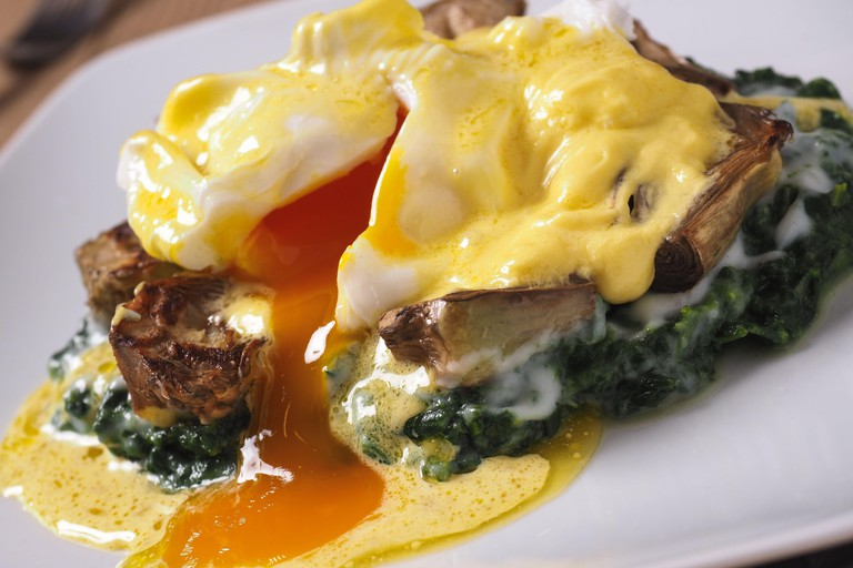 New Orleans traditional eggs sardou, louisiana food  with spinach cream, artichokes, poached eggs and hollandaise sauce