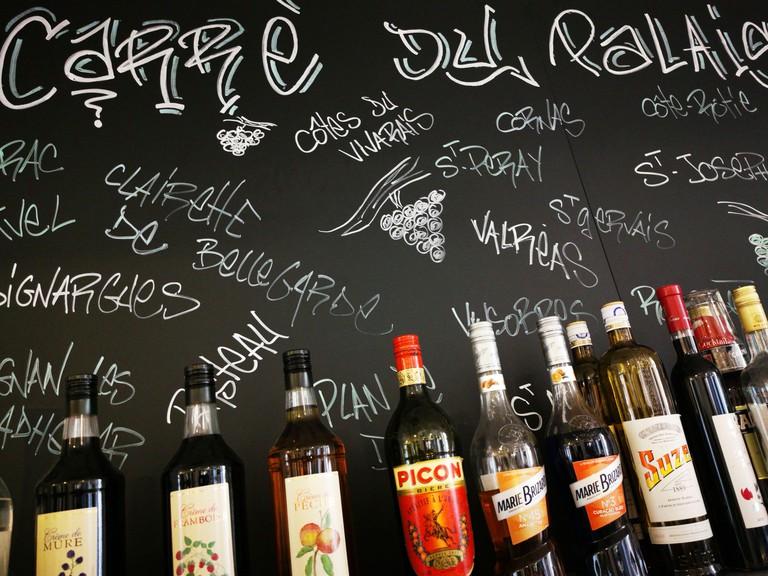 France, Vaucluse, Avignon, Le Carre du Palais restaurant, bottles of alcohol