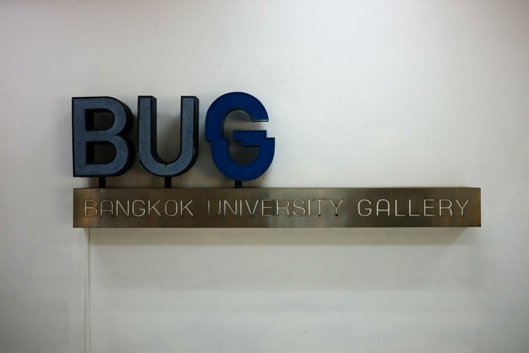BANGKOK, THAILAND - FEBRUARY 25, 2020: BUG gallery sign on white concrete wall. BUG is the art museum in Bangkok university where is a famous private