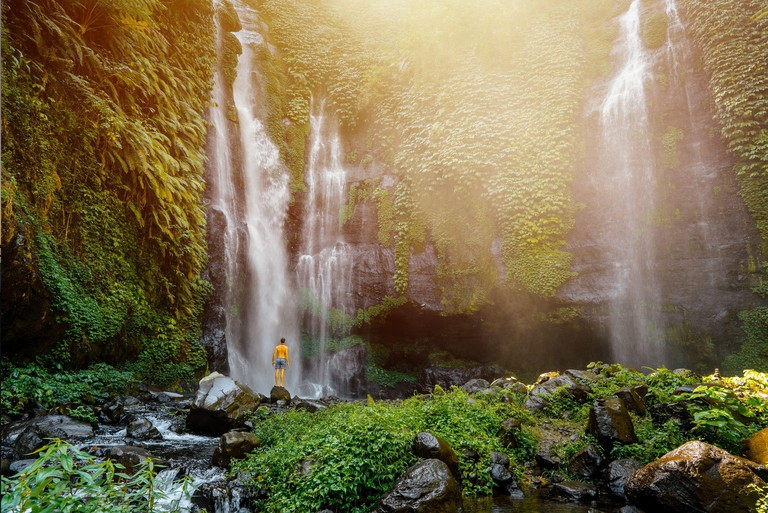 2BYJ38R Sekumpul waterfall in Bali surrounded by tropical forest. Bali island Indonesia - travel and nature background