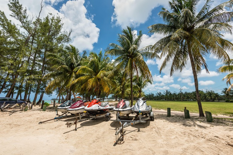 Nassau, Bahamas - May 3, 2019: Jet skis (water scooter, personal watercraft) on the Goodman's Bay Park. Goodman's Bay is a public beach in the east of