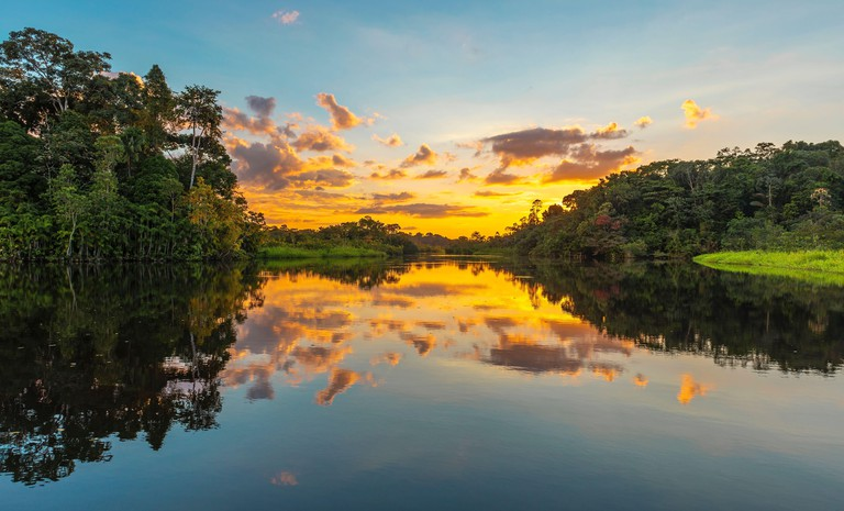 Panorama of a sunset in the Amazon Rainforest which comprise the countries of Brazil, Bolivia, Colombia, Ecuador, Guyana, Peru, Suriname and Venezuela