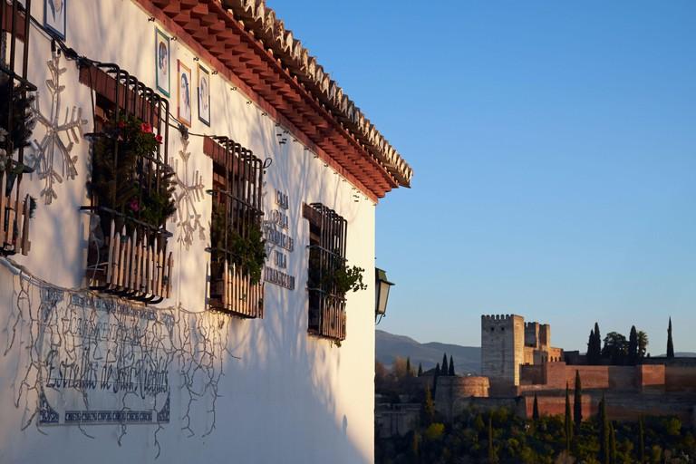 Upper storey of Restaurante Estrellas de San Nicolas with the Alhambra in the background, Albaicin, Granada, Analusia, Spain.