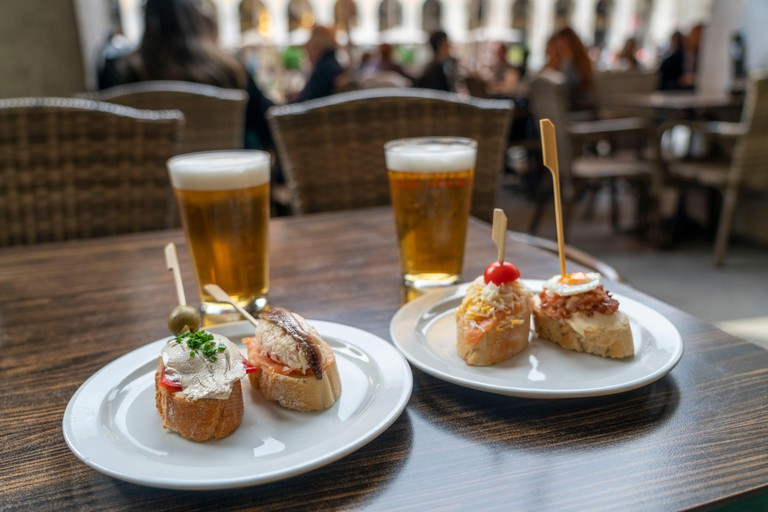 Tapas and beer in a restarant at Place de la Indepencia, Girona, Spain