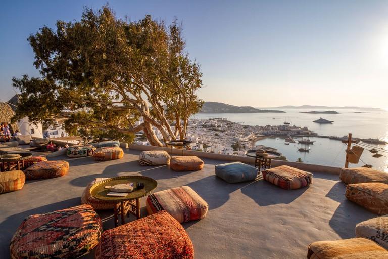 Overlooking Mykonos Town from hilltop at 180º Sunset Bar and Panigirakis Castle - Perfect destination when visiting Mykonos, Cyclades, Greece, EU.