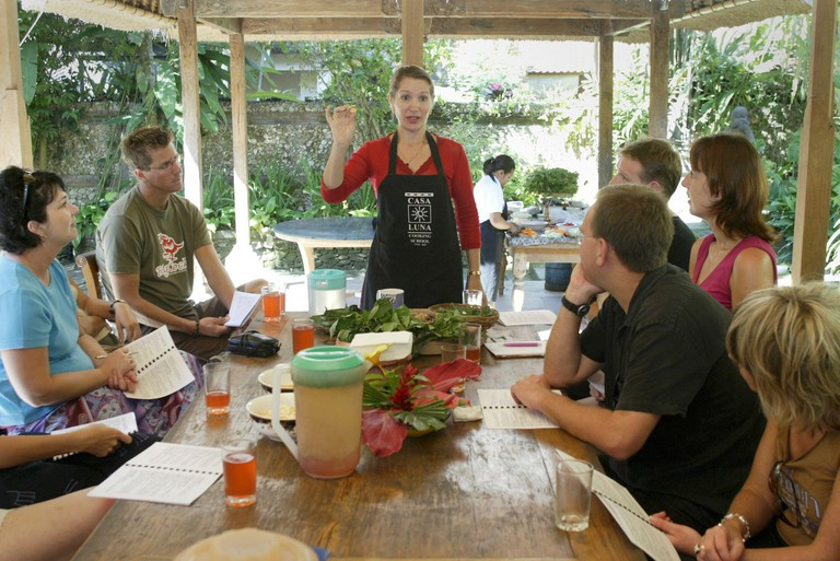 Australian Janet de Neefe teaches a cooking class to Australian andEuropean tourists in the town of Ubud on Bali August 10, 2003. The16-room guesthouse, two restaurants and Casa Luna cooking school thatde Neefe and her Balinese husband own have been bu