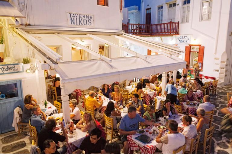 Tourists at an outdoor Taverna at night, Chora, Mykonos Town, Mykonos, Cyclades Islands, Greek Islands, Greece, Europe
