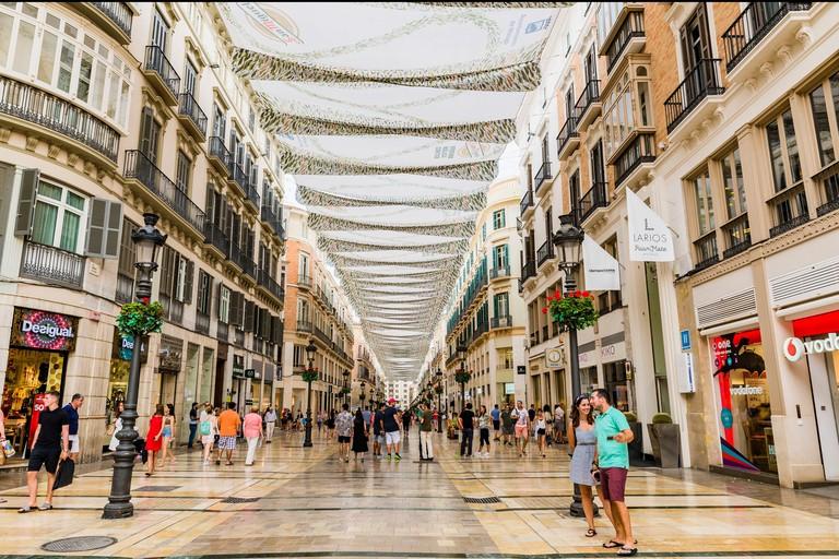 Calle Marques de Larios, pedestrian main street, covered with sun shades. Malaga, Andalucia, Spain, Europe