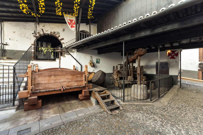 The museum - storage of expensive vintage wine Madeira. An ancient press for a grapes extraction