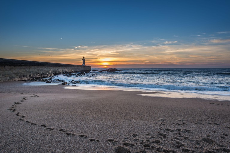 Sunset over Atlantic Ocean. View from Carneiro beach in Foz do Douro district of Porto city, second largest city in Portugal