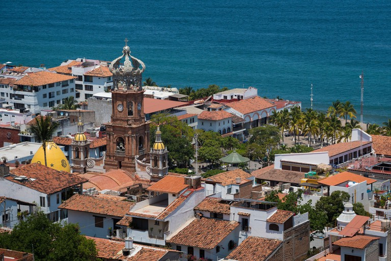 Our Lady of Guadalupe church and the main plaza in Puerto Vallarta, Jalisco, Mexico.