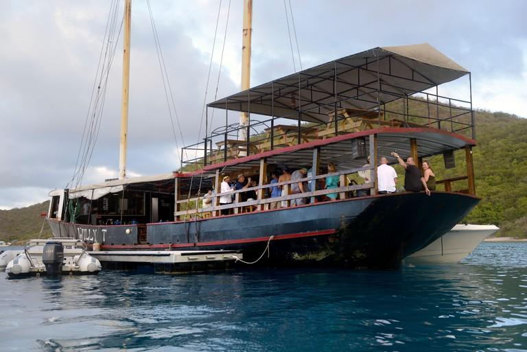 The William Thornton Floating Bar & Restaurant schooner, an old steel ship about 100 feet long, The Bight, Norman Island, British Virgin Islands