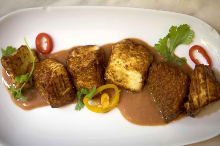 Feb 28, 2018; San Juan, Puerto Rico; Fried local cheese with guava cream sauce is seen at Casita Miramar in San Juan. Mandatory Credit: Carrie Cochran/The Cincinnati Enquirer Sentinel via USA TODAY NETWORK/Sipa USA