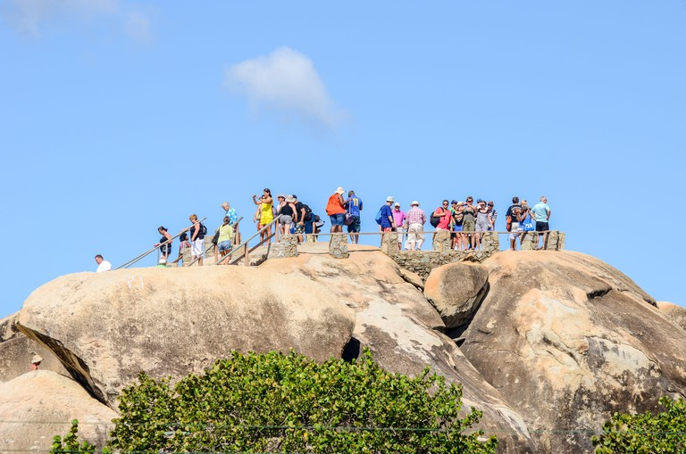 Group of tourists admiring the view from the top of the Casibari Rock Formations at Aruba