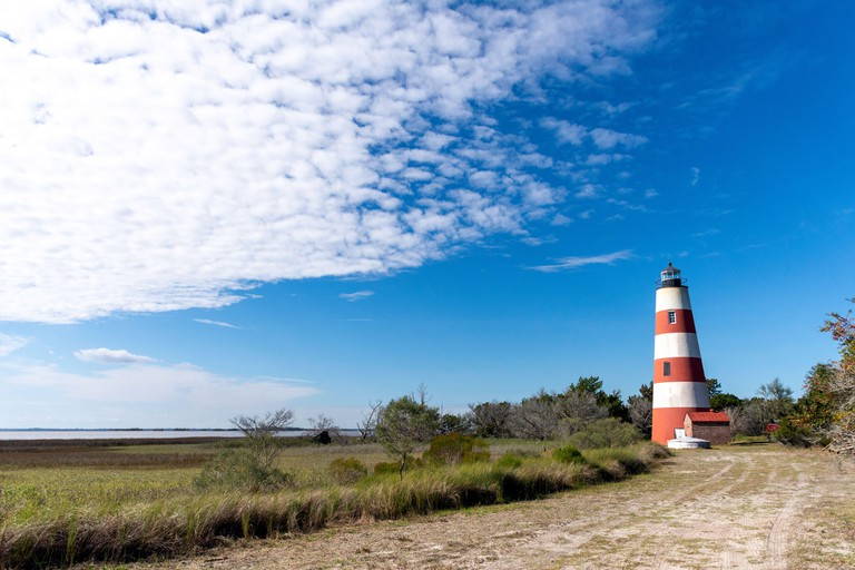 The lighthouse at Sapelo Island, Georgia, USA, the state's fourth largest barrier island and a slow travel destination.