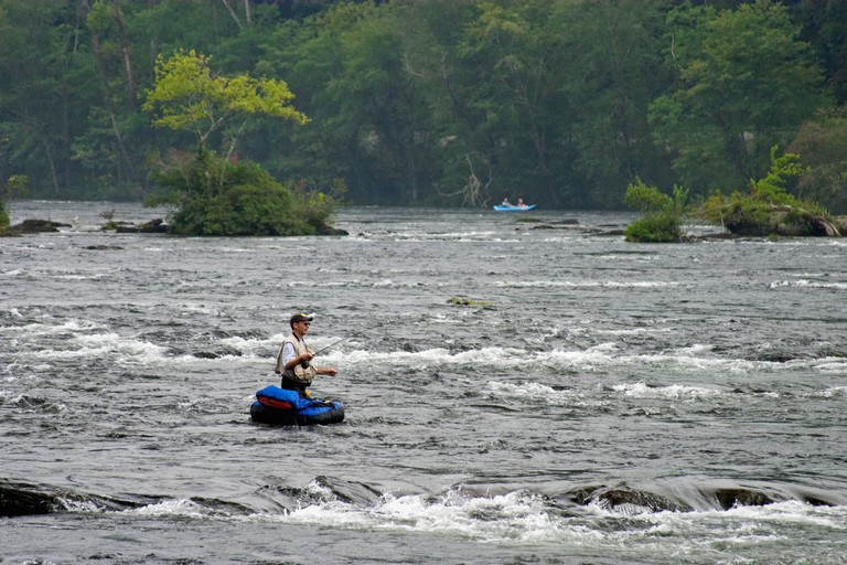 Fly Fisherman in float tube trout fishing the Hiwassee River Tennessee