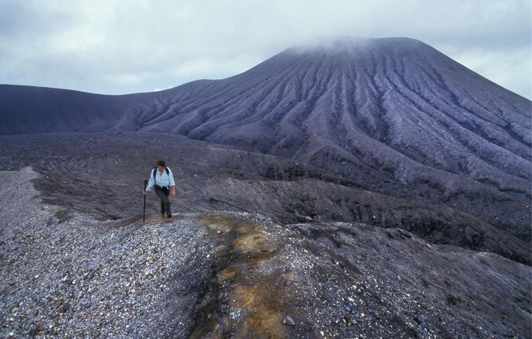 AGMBHR Costa Rica Liberia, Woman climbing the volcano at National Park Rincon de la Vieja
