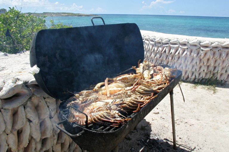 A lobster barbeque on a Caribbean Island in Island Harbour in the caribbean sea off Anguilla