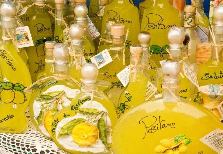 Europe, Italy, Positano. Bottles of limoncello, a lemon liqueur made in southern Italy.