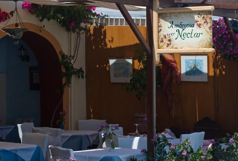 BB4F65 Europe, Greece, Santorini, Thira, Oia. Interior of restaurant Ambrosia Nectar.