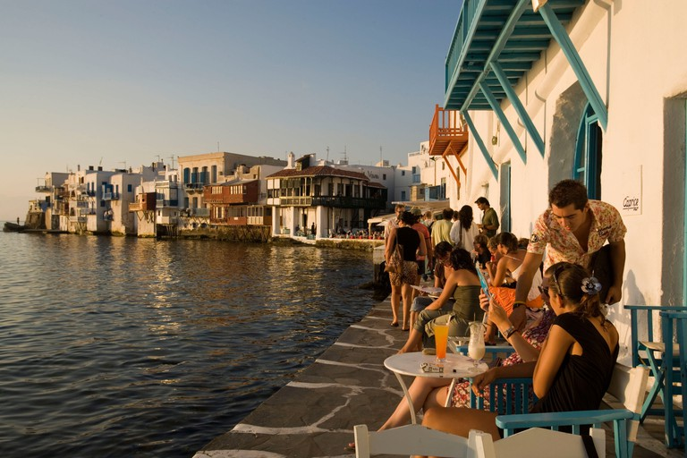 People sitting in the Caprice Bar directly at sea, Little Venice, Mykonos-Town, Mykonos, Greece