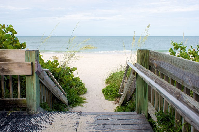 looking down wooden steps leading to beach, bonita beach, florida