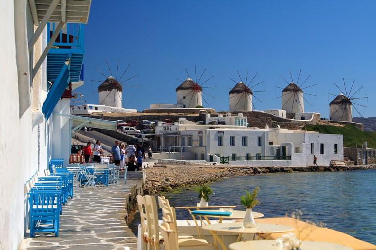 "The famous windmills of Myconos island as seen from ""Little Venice"". Myconos, Cyclades, Greece"