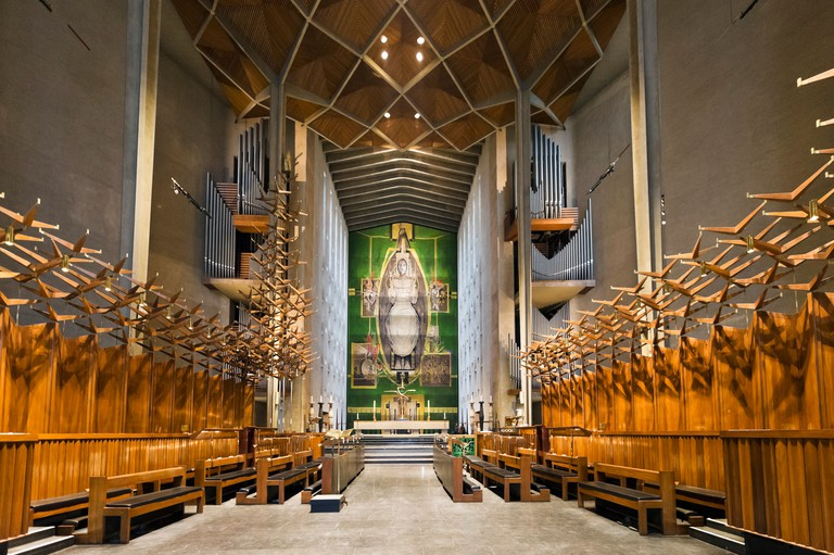 The nave of new St Michaels Cathedral with Graham Sutherland's tapestry 'Christ in Glory' at end, Coventry, West Midlands, UK