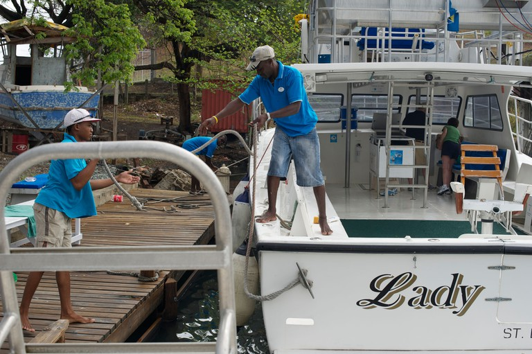 Caribbean scenes : Castries,St Lucia. Crew prepare for whale watch tour