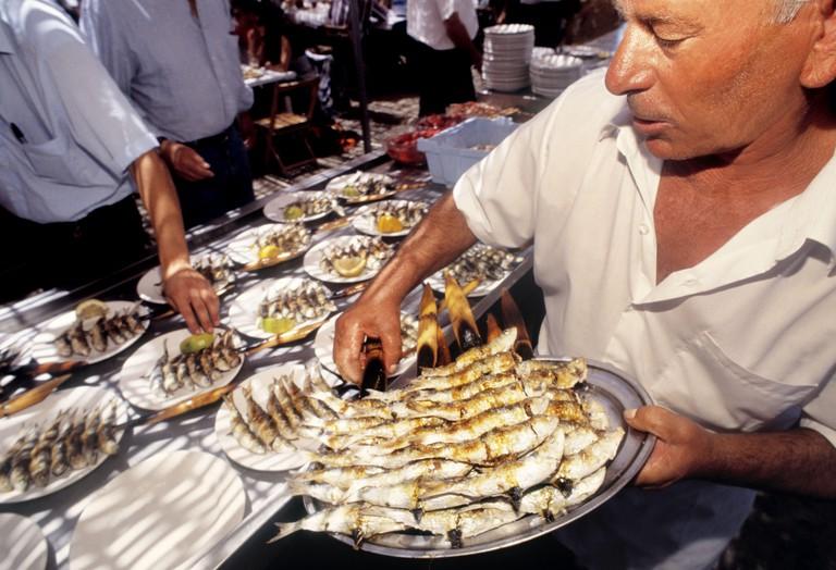 DDK2F6 Food: ´Espeto de sardinas´ (grilled sardines) at El Tintero restaurant on Malaga beach. Malaga. Andalucia. Spain.