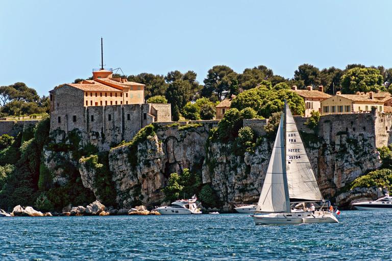 Europe, France, Alpes-Maritimes, Cannes. Sailboat front of fort Sainte Marguerite Lerins islands.
