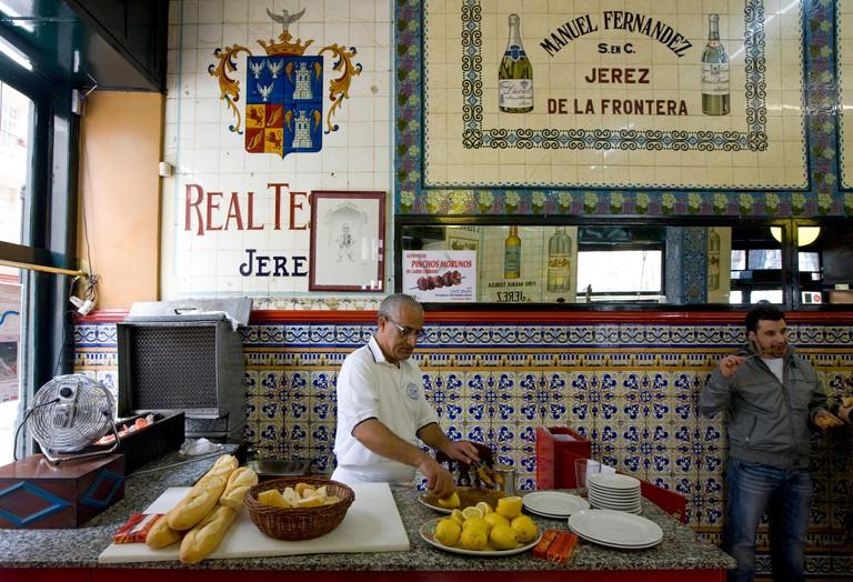 "Cafe Iruna in Bilbao making ""pinchos morunos"" skewers with ham and spicies"