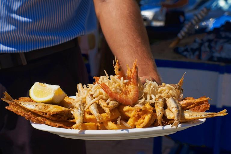 Pescaito frito, Grilled fish on restaurant terrace, Chiringuito, Benalmadena, Costa del Sol, Malaga, Andalusia, Spain, Europe