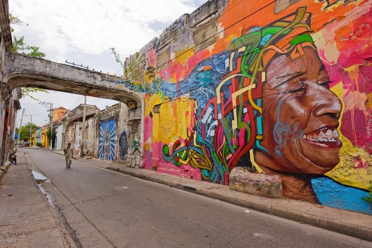 EPM8CN Walls in a street in Getsemani, Cartagena, Colombia, South America, covered in street art (graffiti)