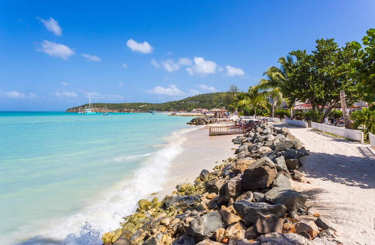 Dickenson Bay beach in north Antigua with blue sky and turquoise sea on a sunny day, Antigua and Barbuda, West Indies