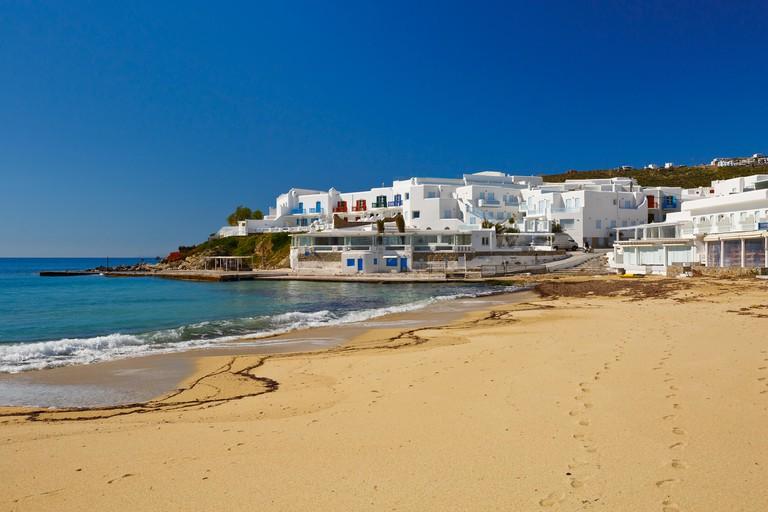 FKRHAH Platis Gialos Beach surrounded by hotels on Mykonos island, Greece.