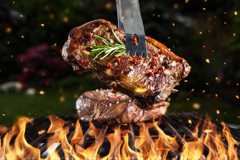 G2FN5G Beef steak on grill with black background