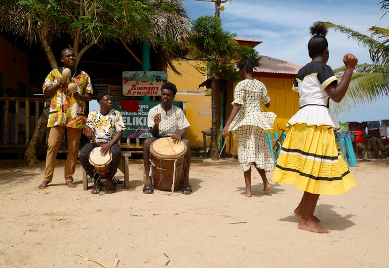 Hopkins Village, Belize - July 03, 2016: Garifuna troupe performs traditional songs with drumming and dancing in Hopkins Village