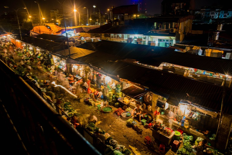 A view of the Long Bien Market which runs through the night in Hanoi.