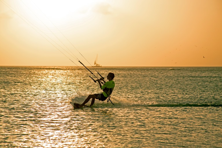Kite surfer on Aruba island in the Caribbean at sunset